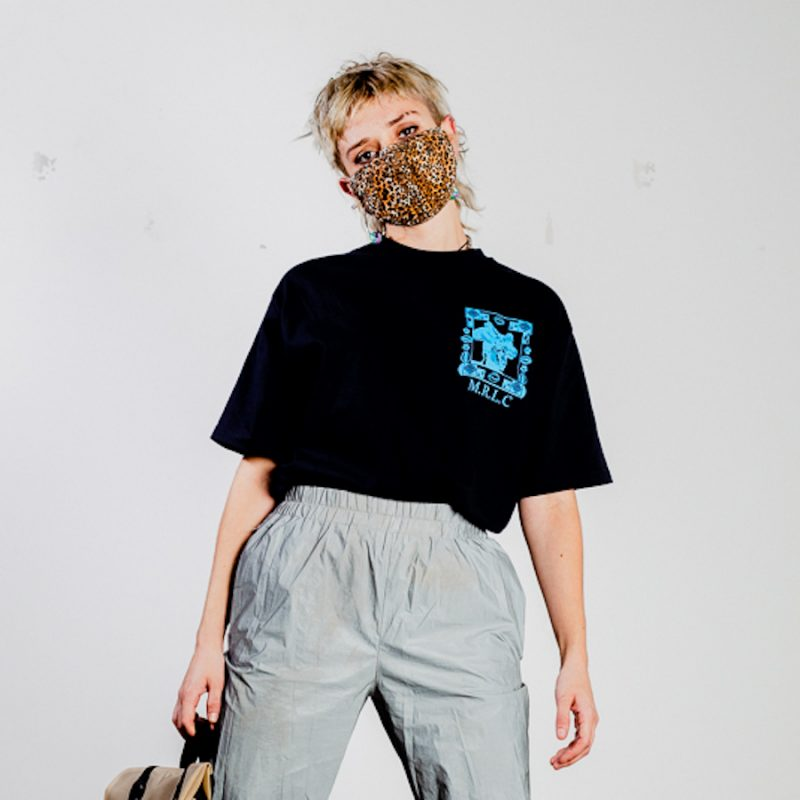 person wearing navy printed top