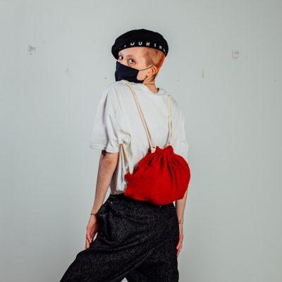 person wearing red drawstring bag