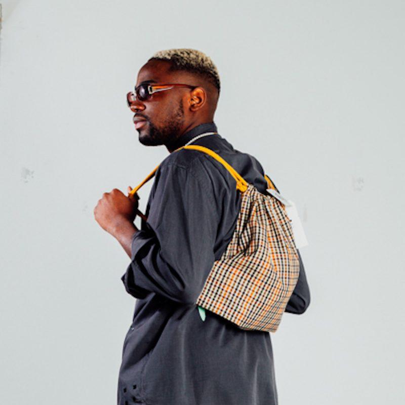 person wearing tartan bag