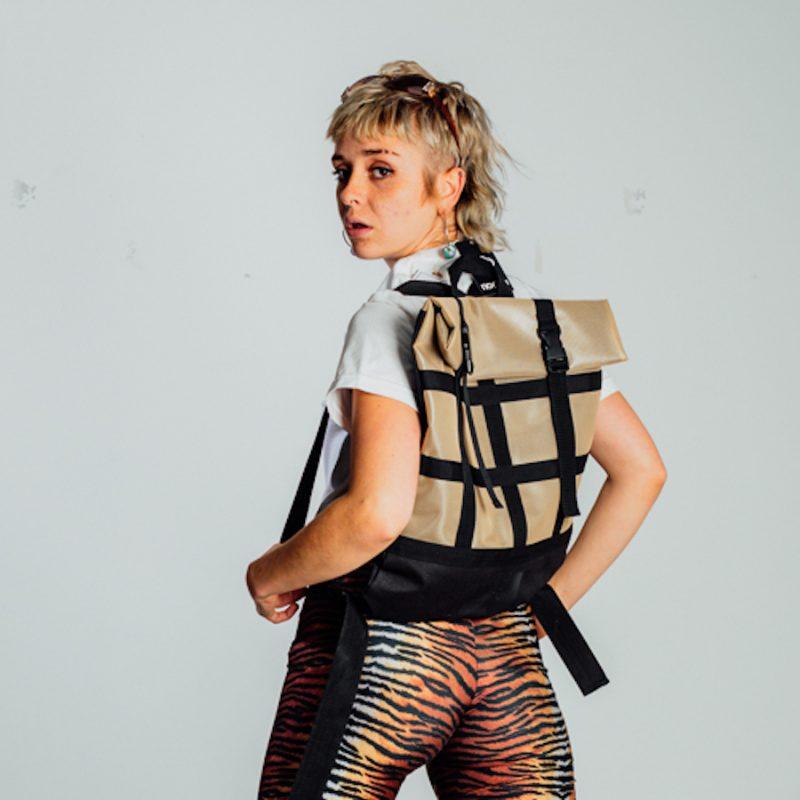person wearing beige backpack