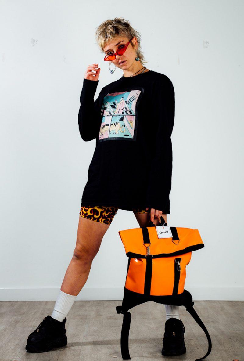 person holding orange bag