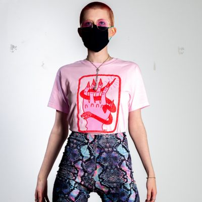 person wearing pink top with red hand print